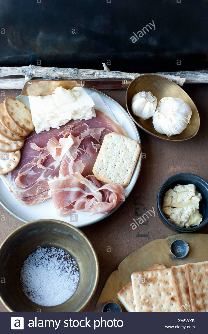 Meat, cheese, crackers and garlic Stock Photo