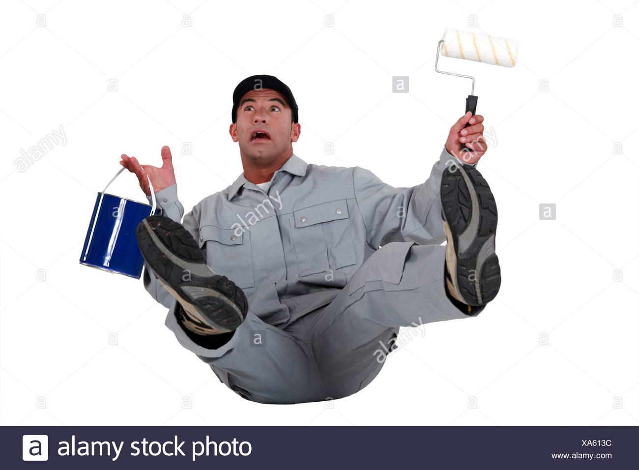Decorator falling over - Stock Image