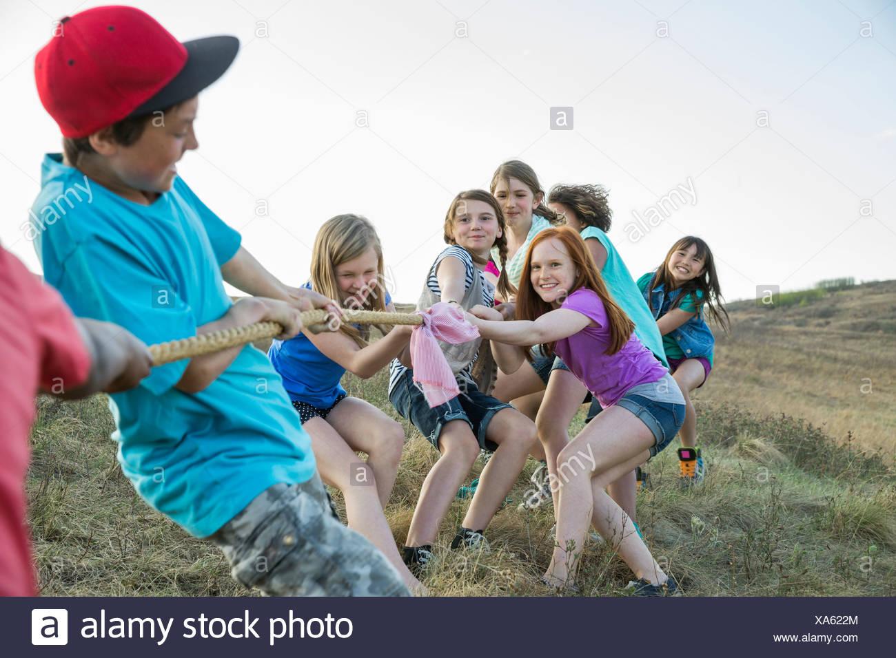 Schoolchildren playing tug-of-war - Stock Image