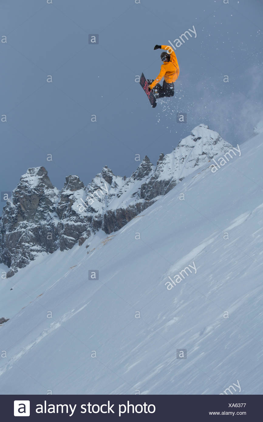 Snowboard jump in front of Tschingelhörner - Stock Image