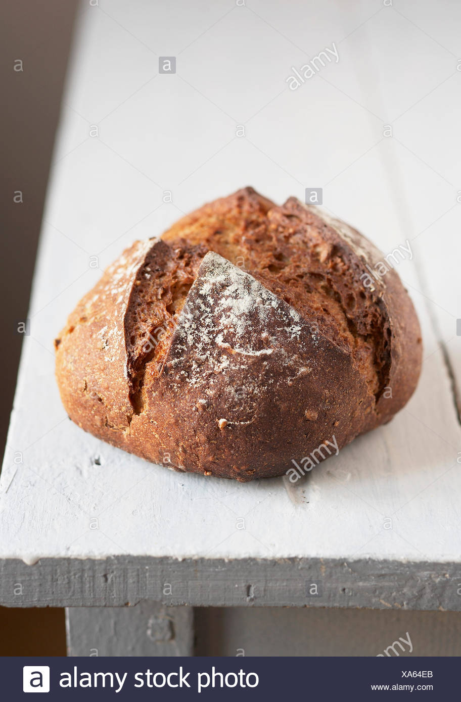 Round loaf of brown bread - Stock Image