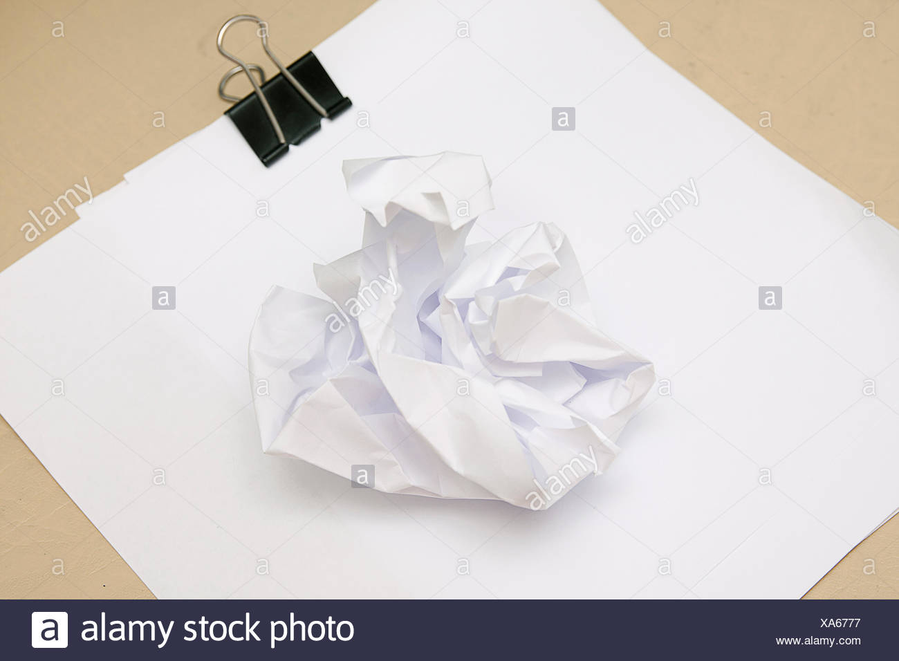 piece of screwed up white paper - Stock Image