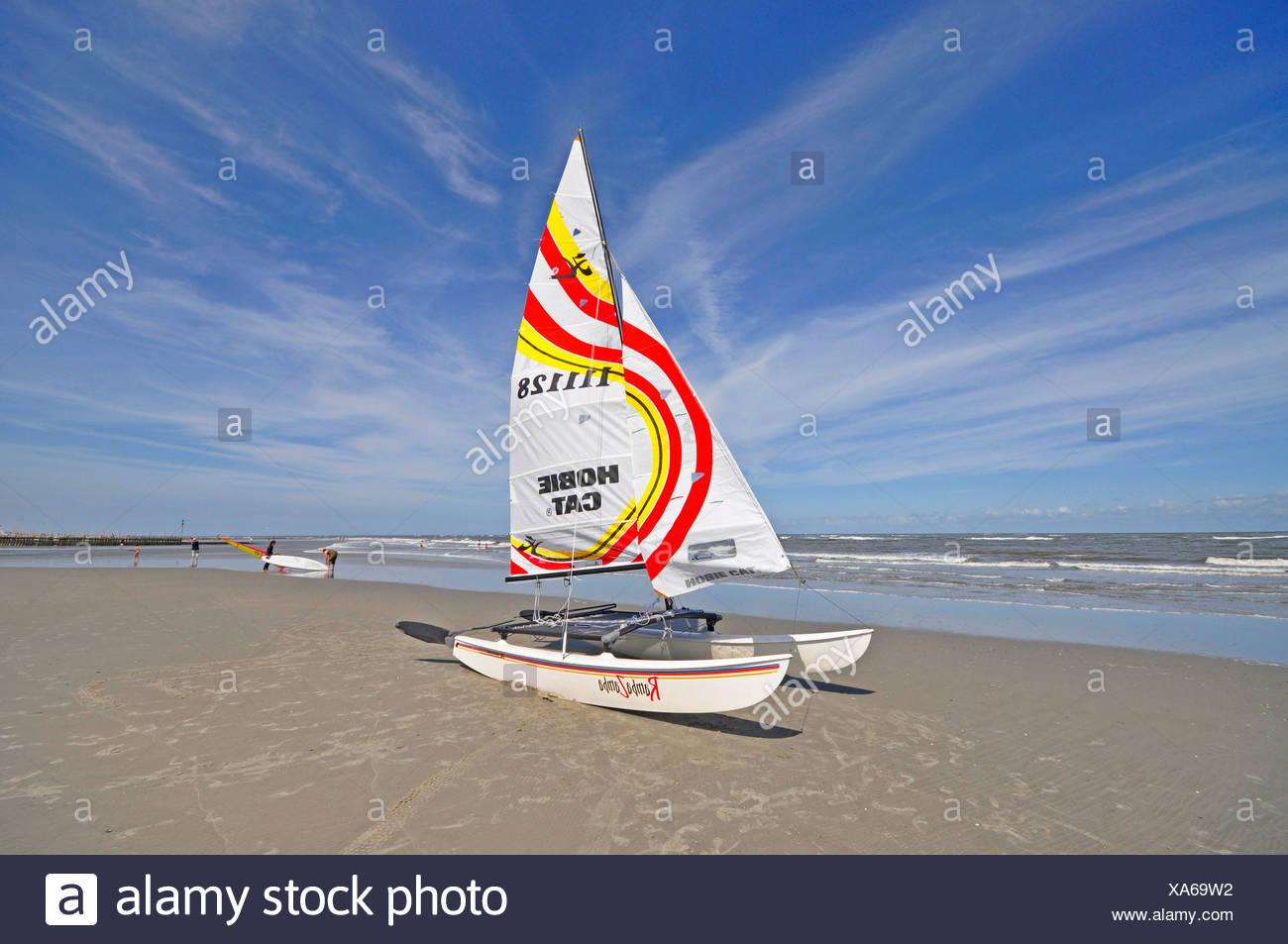 catamaran on the sand beach, Germany, Lower Saxony, East Frisia Stock Photo