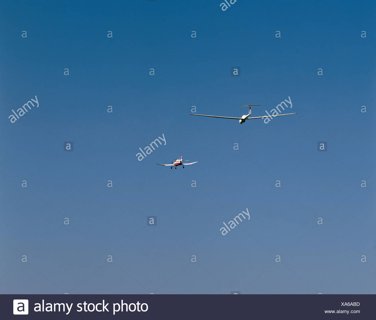 airplane fly extreme towed airplane sail airman sky - Stock Image