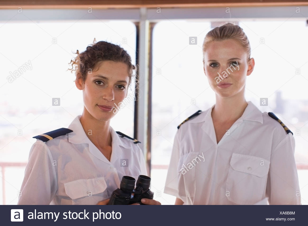 Female sailors with telescope - Stock Image