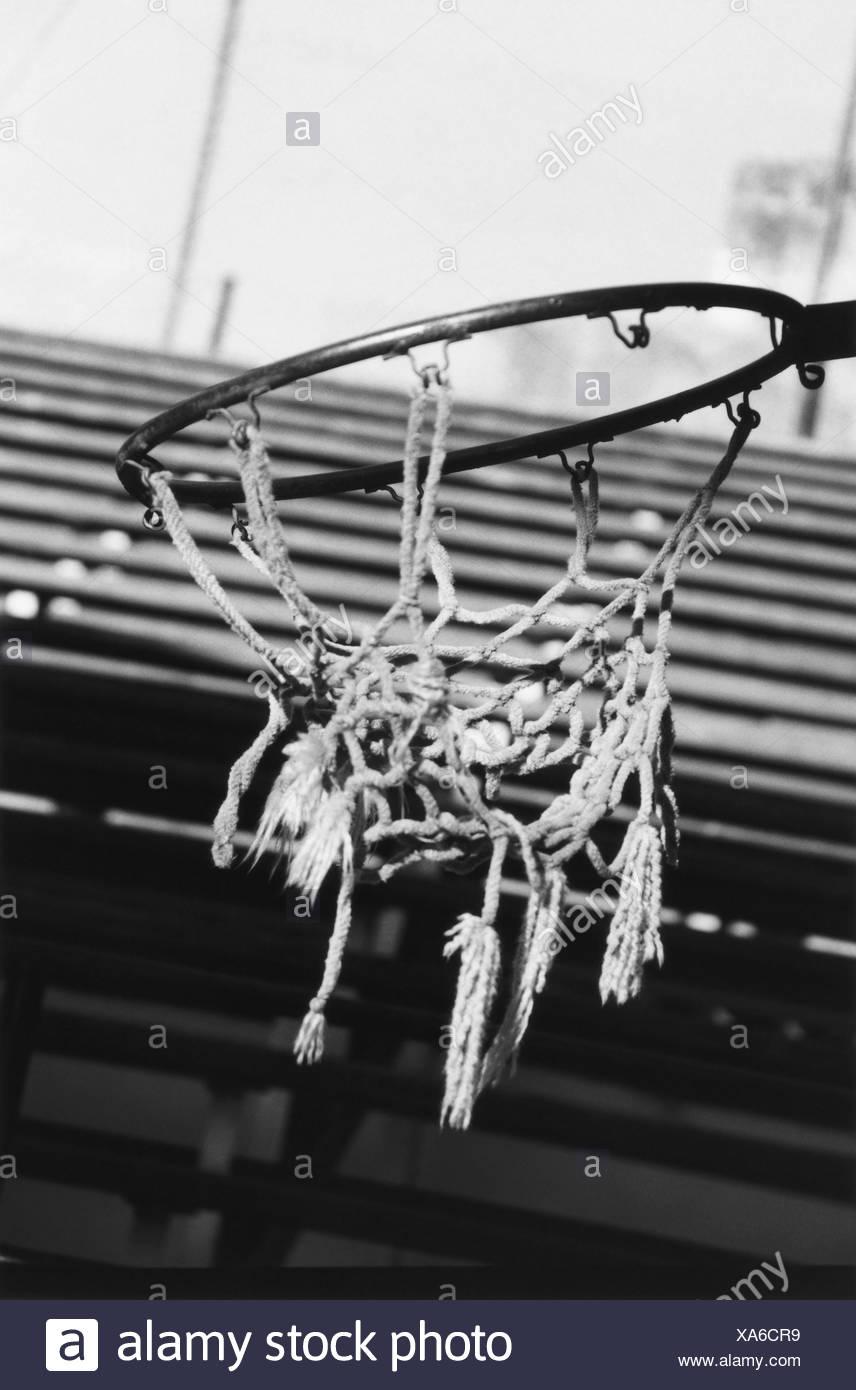 Torn basketball net stock image