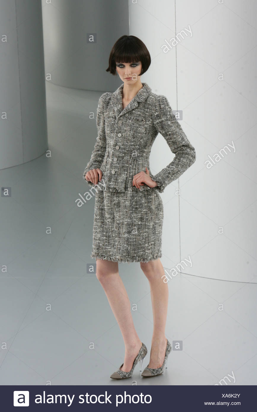 e0e5bde740 Chanel Prive Paris Haute Couture Autumn Winter Model wearing a bell shaped  knee length grey tweed skirt, matching tailored