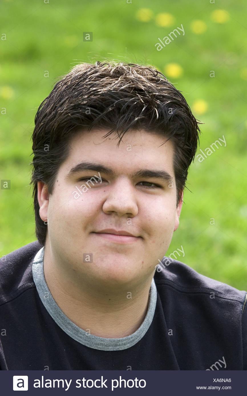 Headshot  plus sized young man - Stock Image