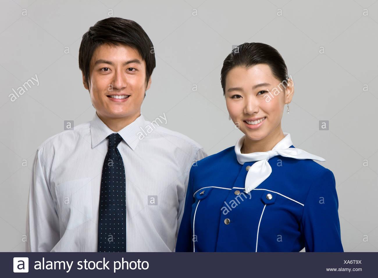 Smiling Flight Attendant - Stock Image