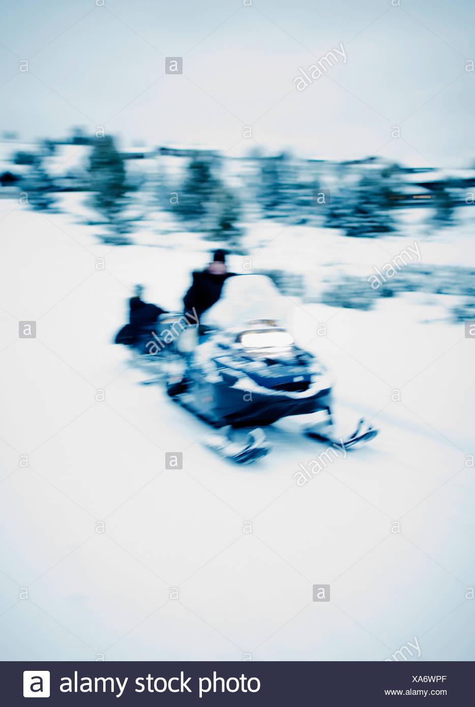 Man on snowmobile - Stock Image