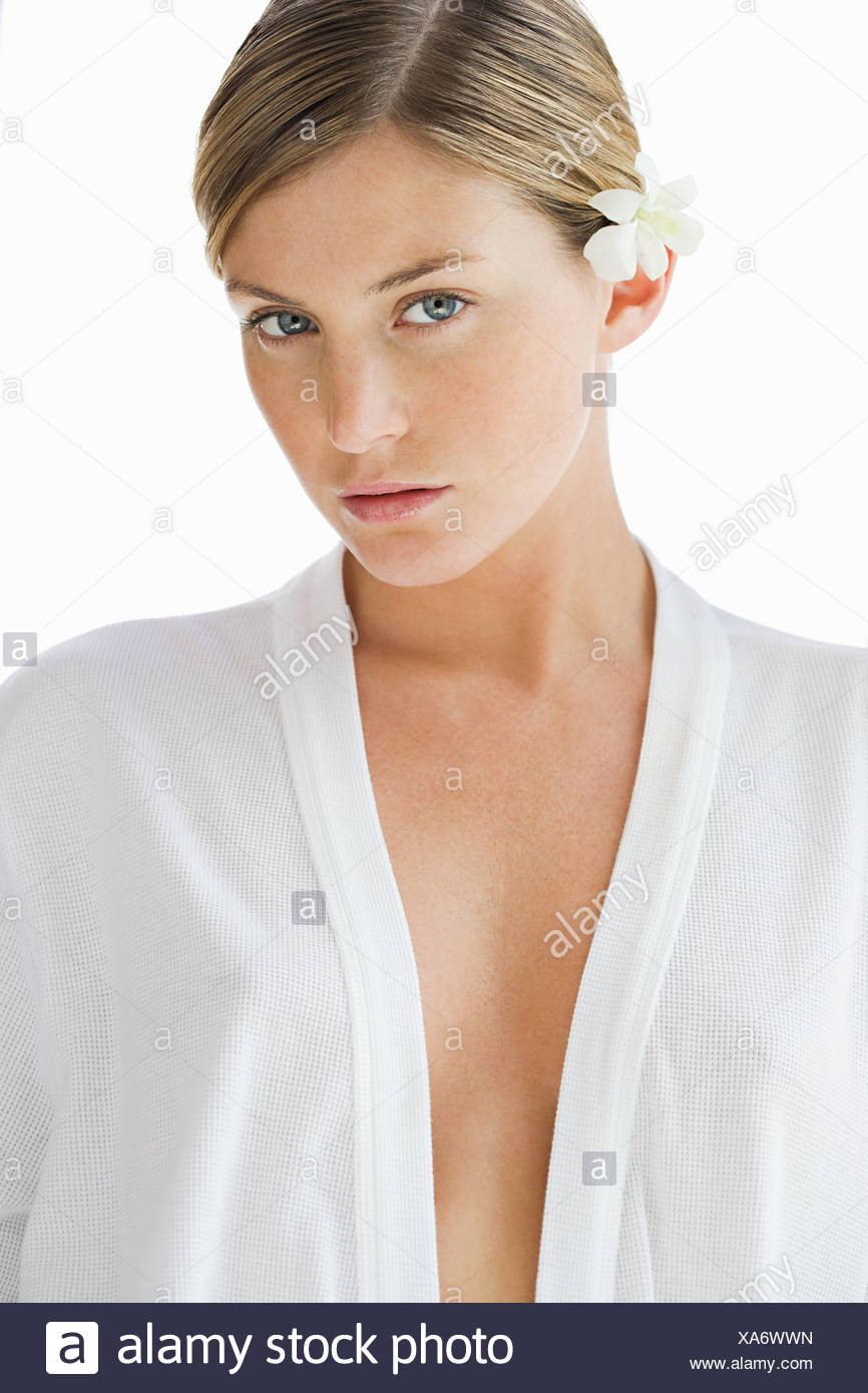 Portrait of young woman at health spa with flower in hair Stock Photo