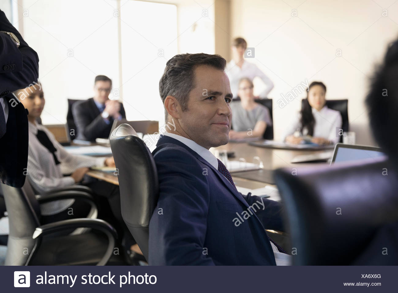 Stupendous Confident Male Lawyer Listening In Conference Room Meeting Home Interior And Landscaping Ponolsignezvosmurscom