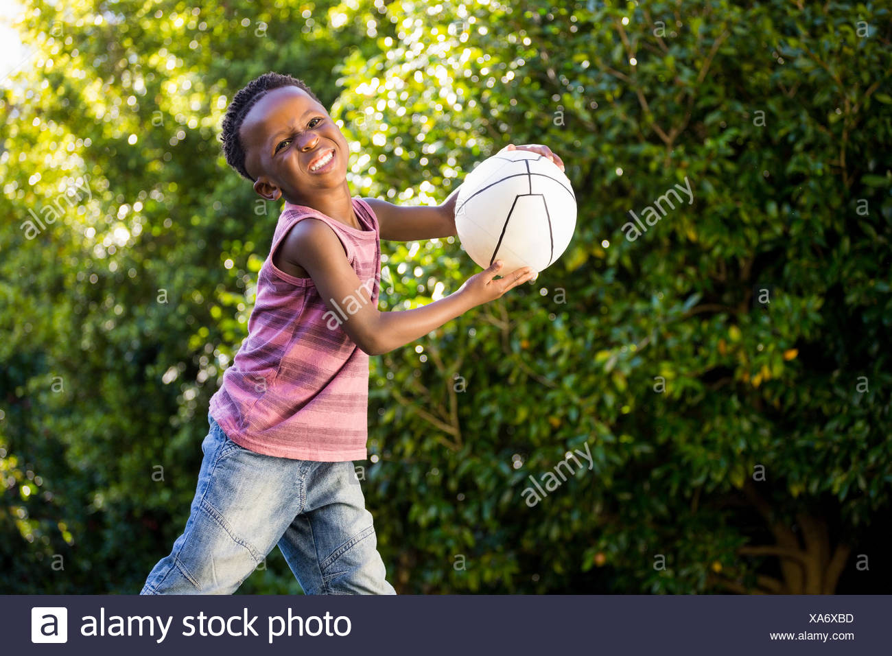 Boy is playing with baloon - Stock Image