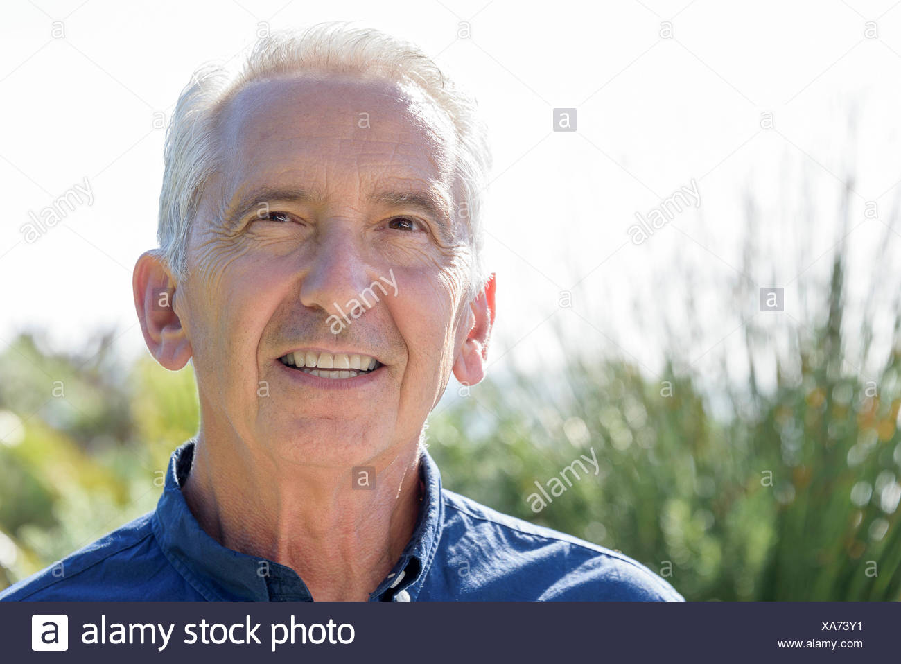 Portrait of a happy senior man smiling - Stock Image