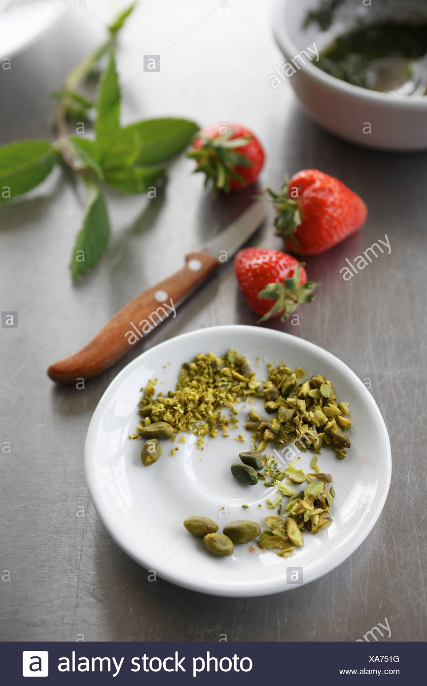 Close up of strawberries and crushed pistachios - Stock Image