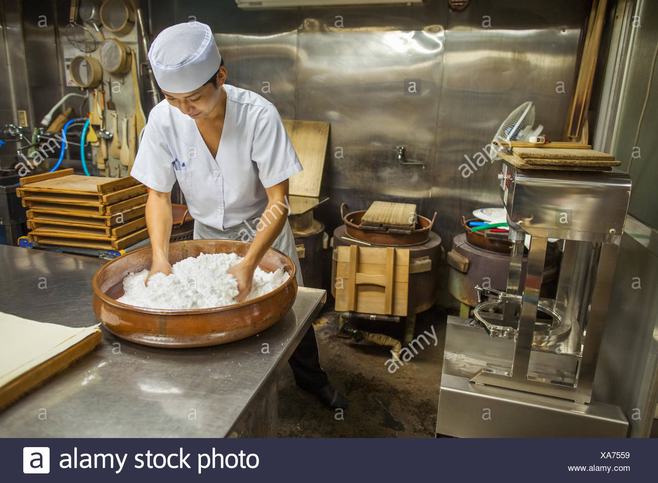 A small artisan producer of wagashi. A man mixing a large bowl of ingredients - Stock Image