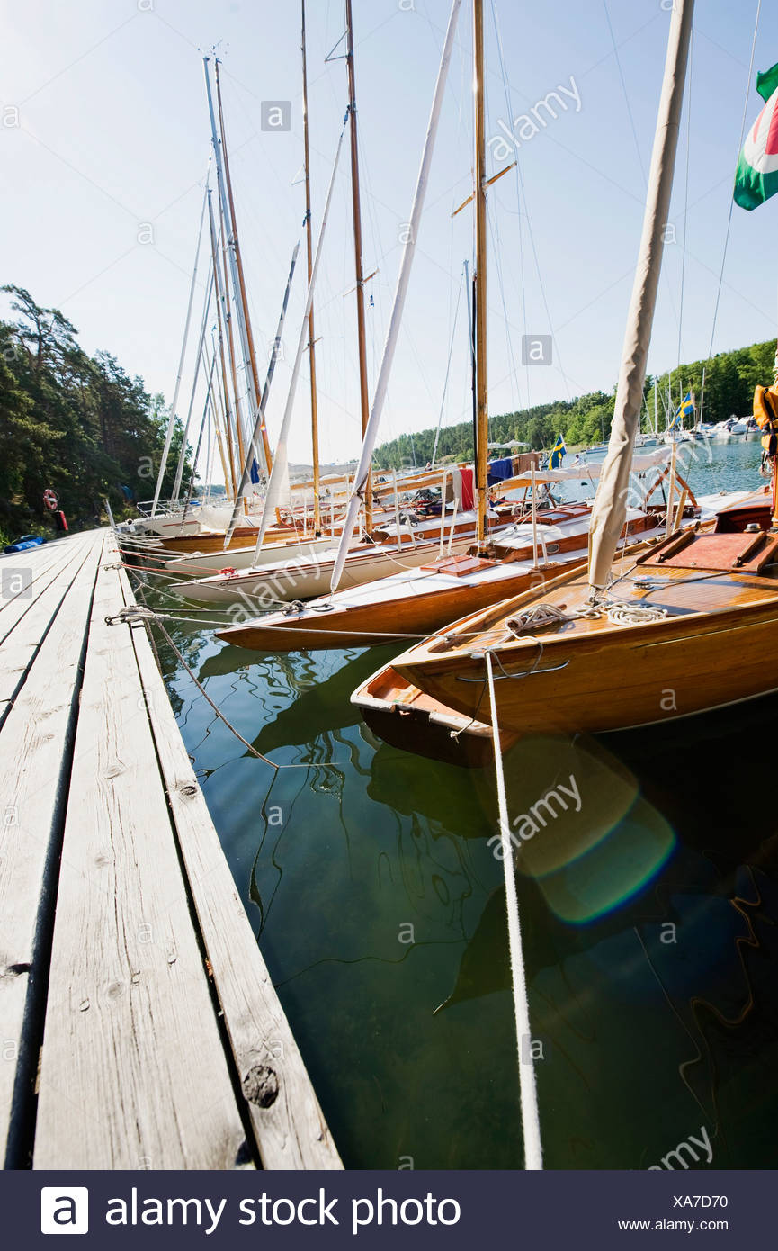 Sailing boats by the pier - Stock Image