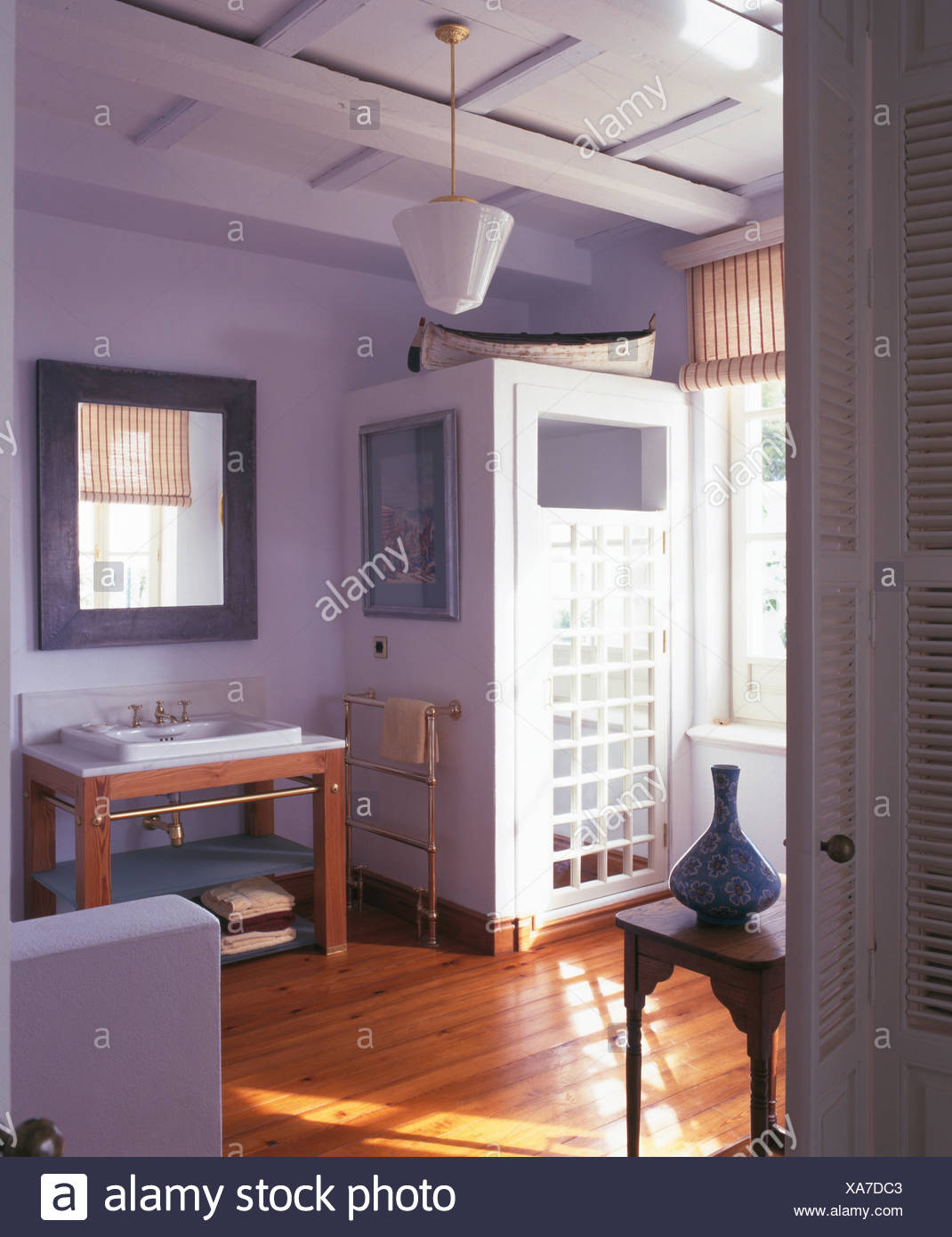 Trellis door on shower cabinet in pale blue-mauve Spanish bathroom with a wooden floor & Trellis door on shower cabinet in pale blue-mauve Spanish bathroom ...