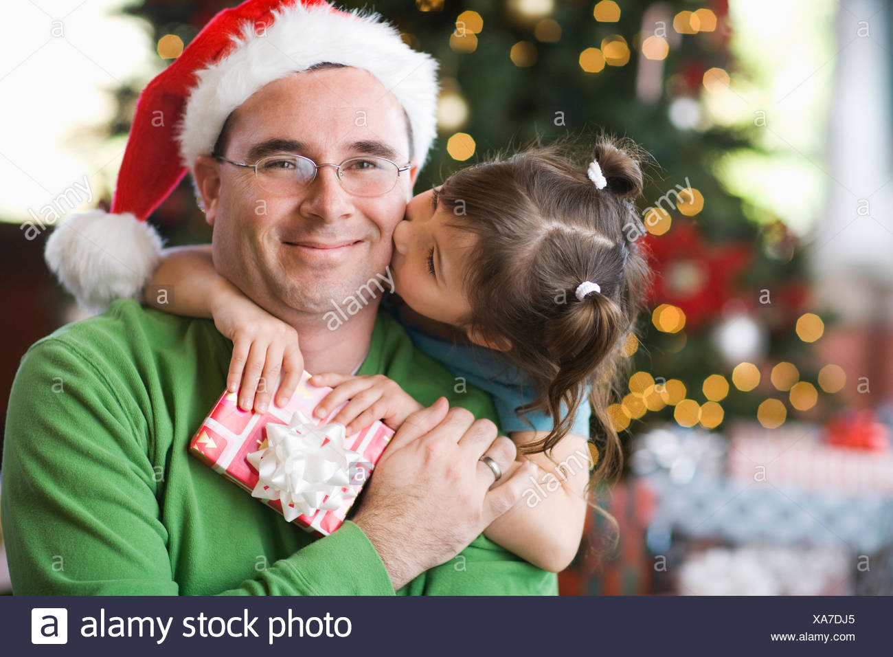 A Man And Girl Father Daughter Hugging Exchanging Presents By