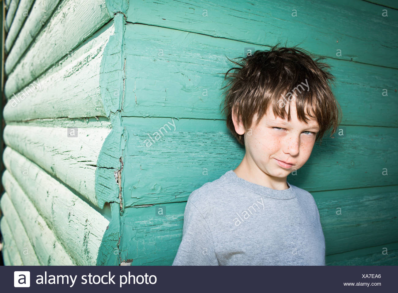 Boy being cheeky to camera - Stock Image