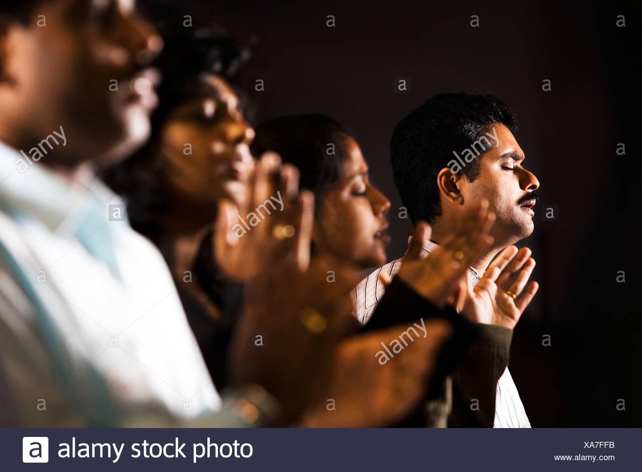 Group praying - Stock Image