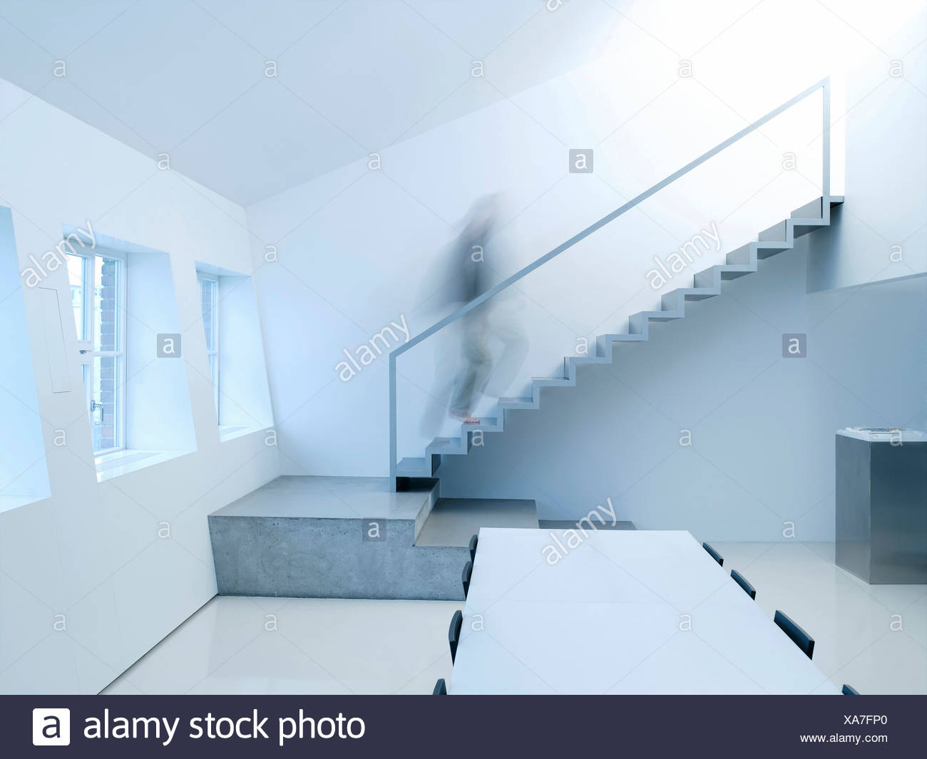 Person walking upstairs, side view - Stock Image