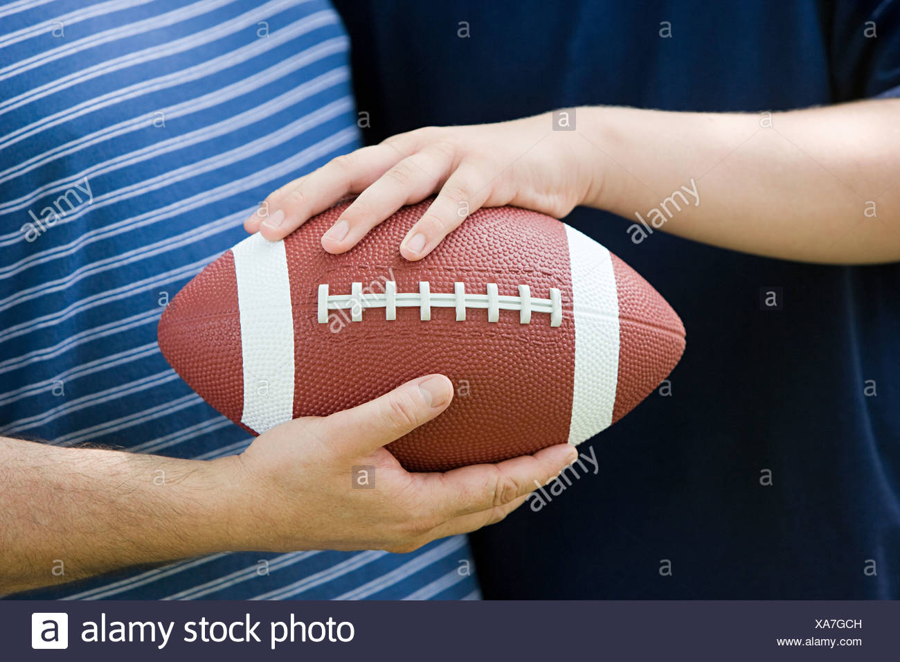 Father and son with american football Stock Photo