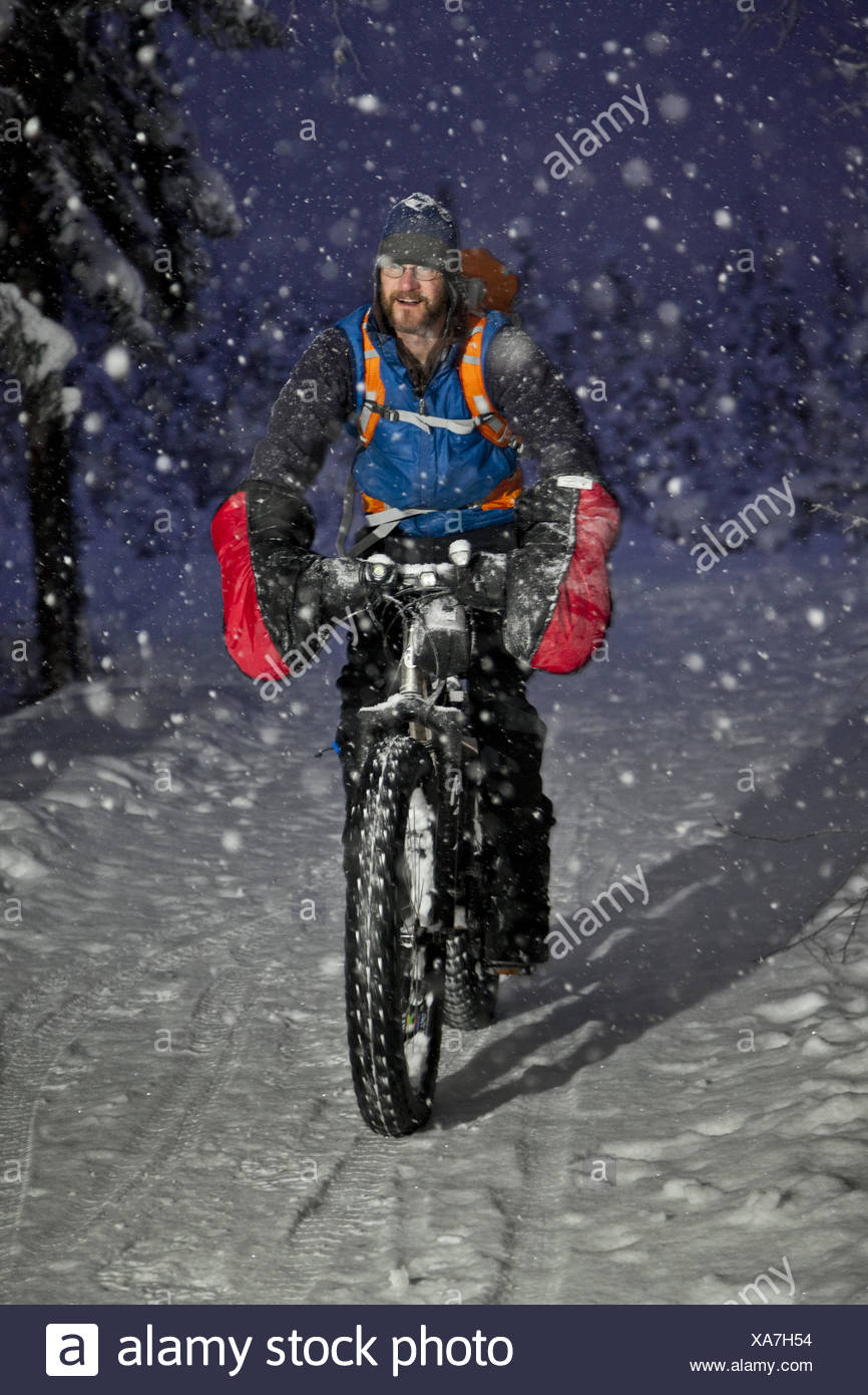 Winter Cyclist Riding His Fatbike On The Chester Creek Trail In Anchorage Southcentral Alaska