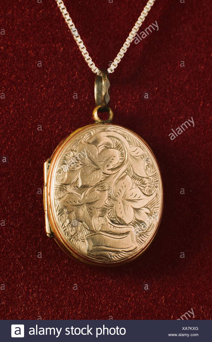 embossed gold victorian locket - Stock Image