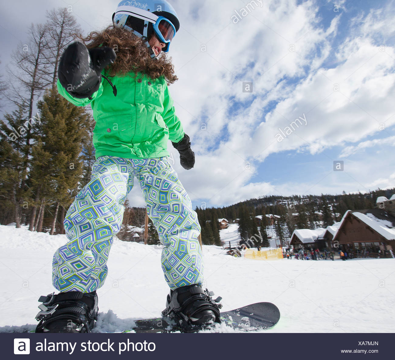 USA, Montana, Whitefish, Girl on snowboard - Stock Image