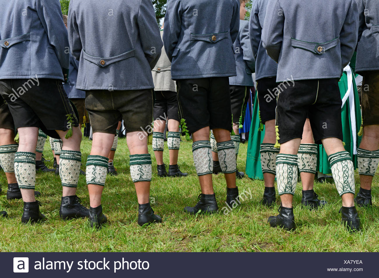 Men in leather trousers and traditional Loferl, traditional costume parade, Oberland Gaufest in Baiernrain, Upper Bavaria - Stock Image