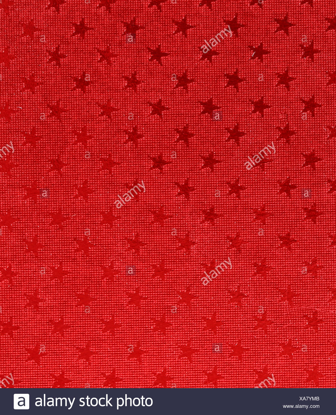 Asterisks on red background. - Stock Image