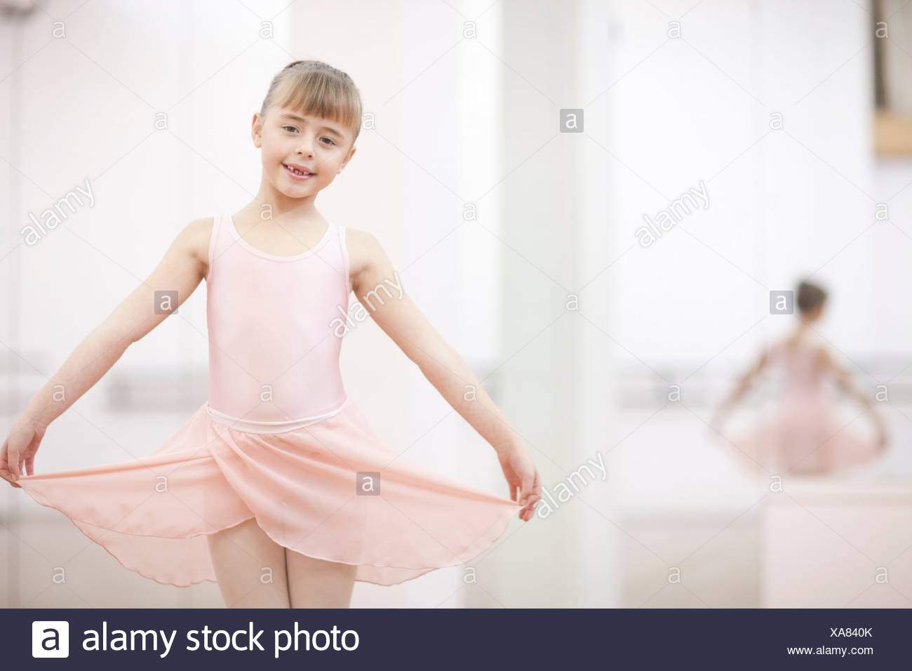 Portrait of a young ballerina holding skirt - Stock Image