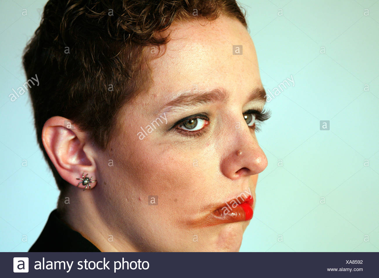 Face with smudged make-up - Stock Image