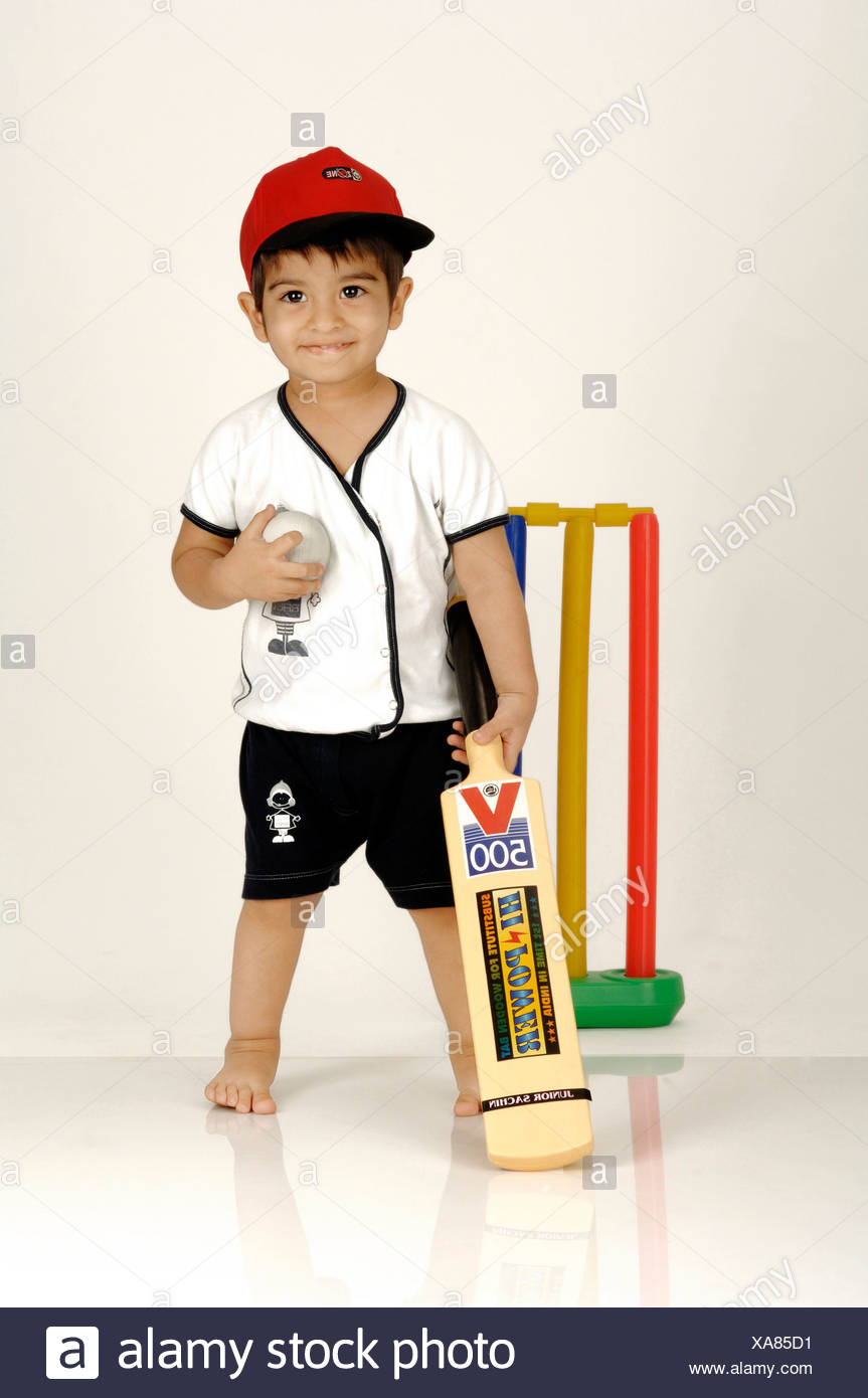Indian Boy with Bat & Ball ready to Play Cricket ; Proud Batsman ; MR - Stock Image