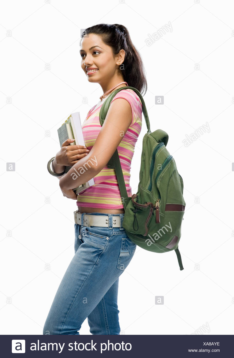 Female college student holding files - Stock Image
