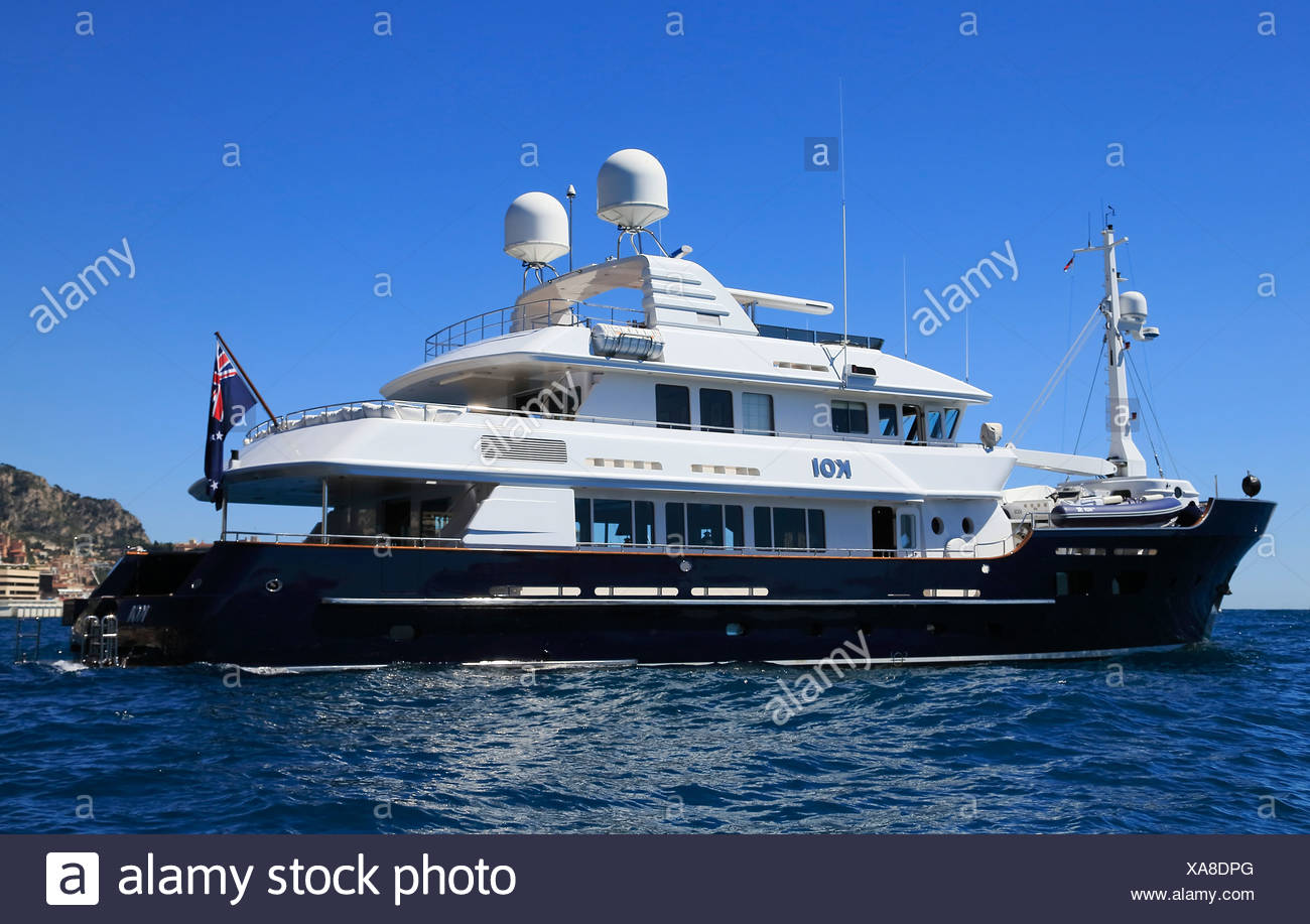 McMullen & Wing motoryacht Koi at anchor in front of the Principality of Monaco - Stock Image
