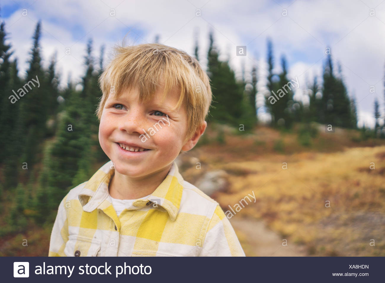 Portrait of a smiling boy outdoors - Stock Image