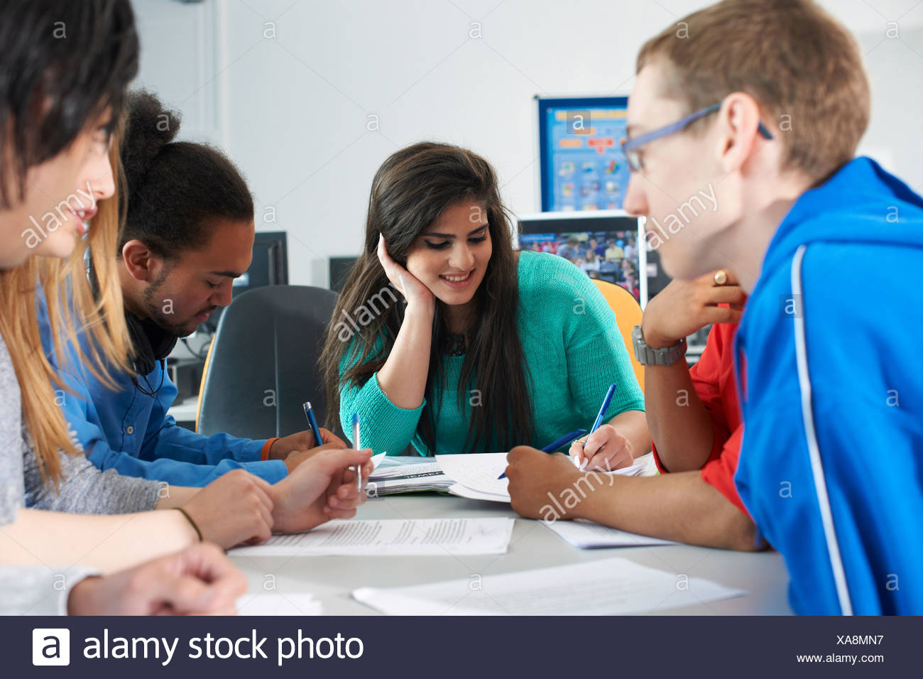 Group of college students studying together - Stock Image