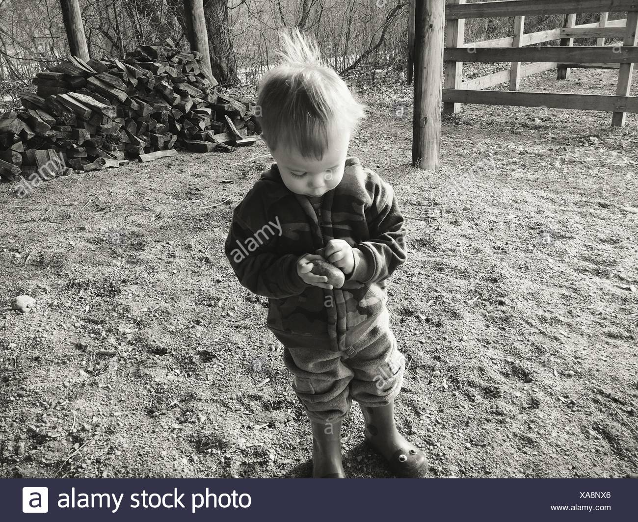 Boy Playing With Stone - Stock Image