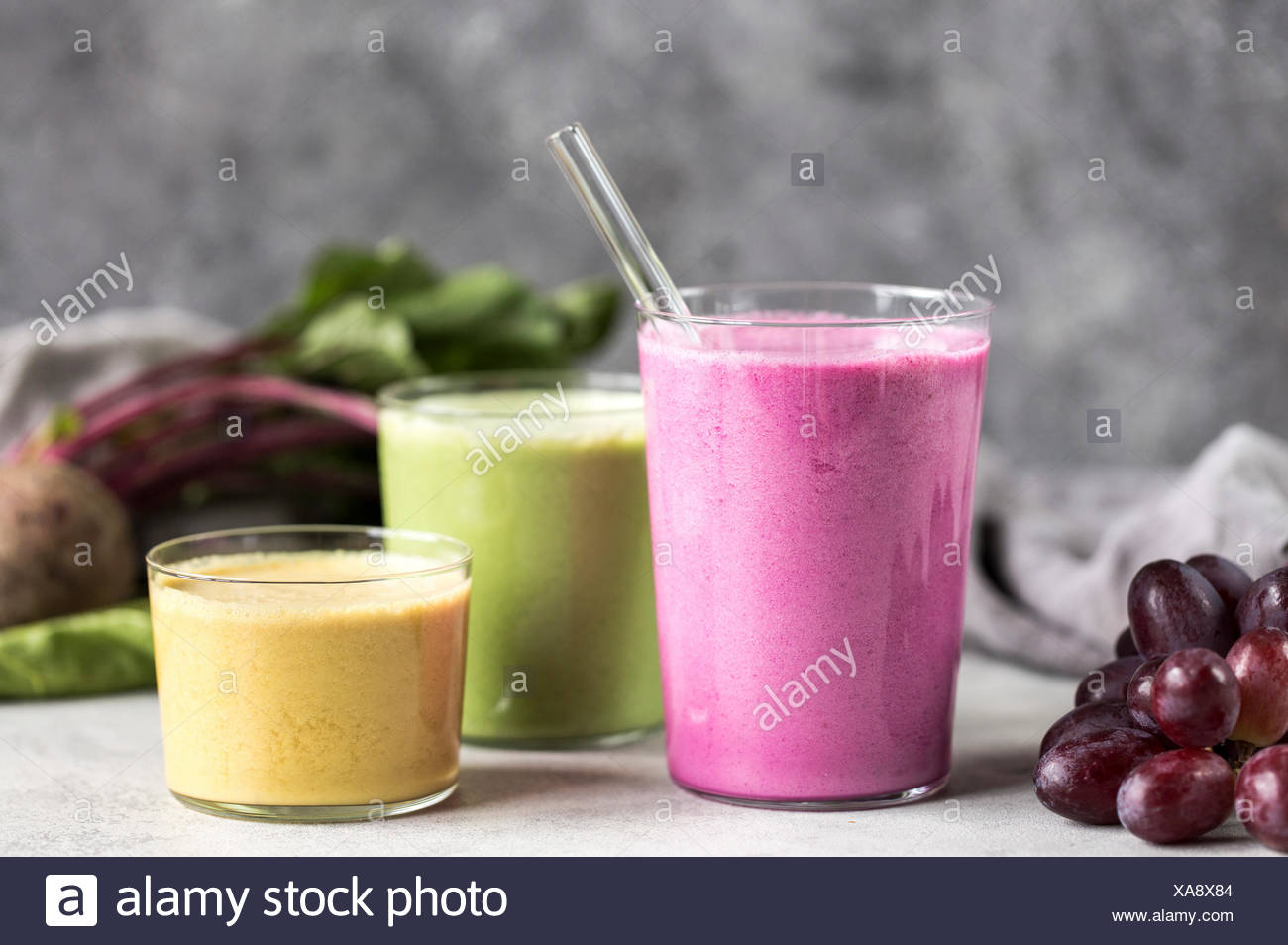 3 glasses of Multi-Colored Beet Smoothies are photographed from the front view. - Stock Image