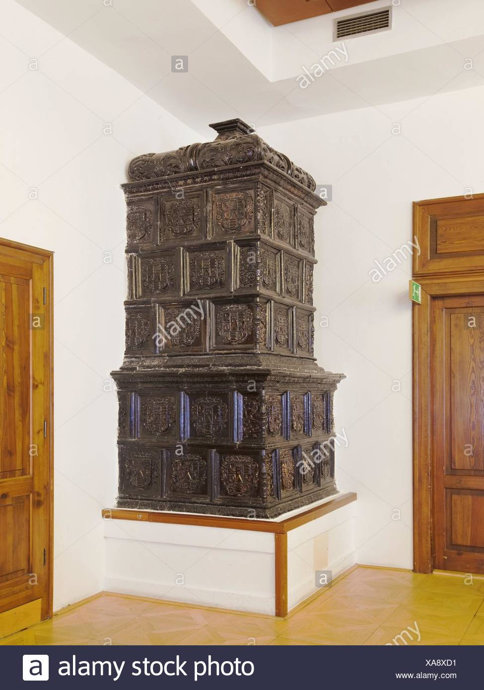 Ornate antique  stove in the corner of a room Stock Photo