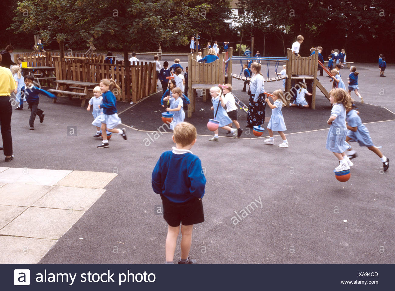 primary school children in the playground - Stock Image