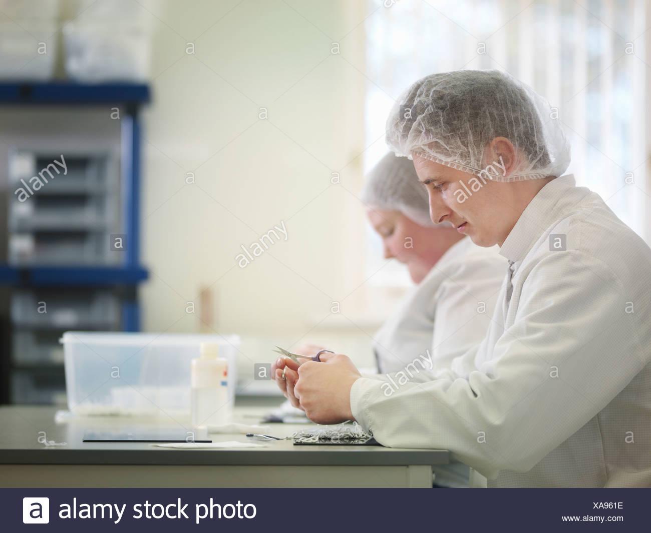 Laboratory Technician Production Line - Stock Image