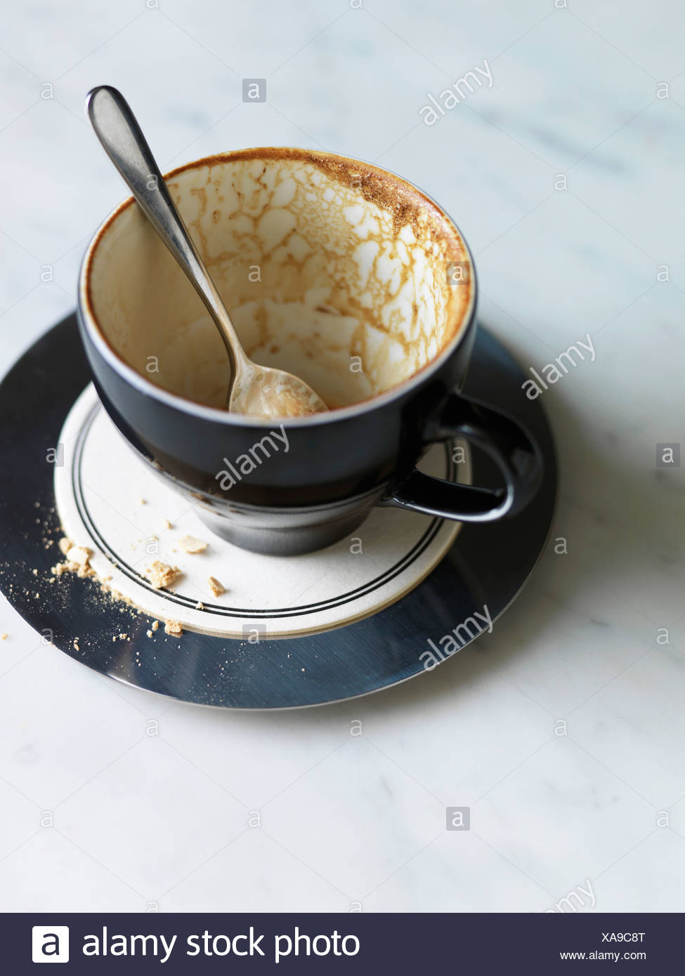 A finished cup of coffee - Stock Image