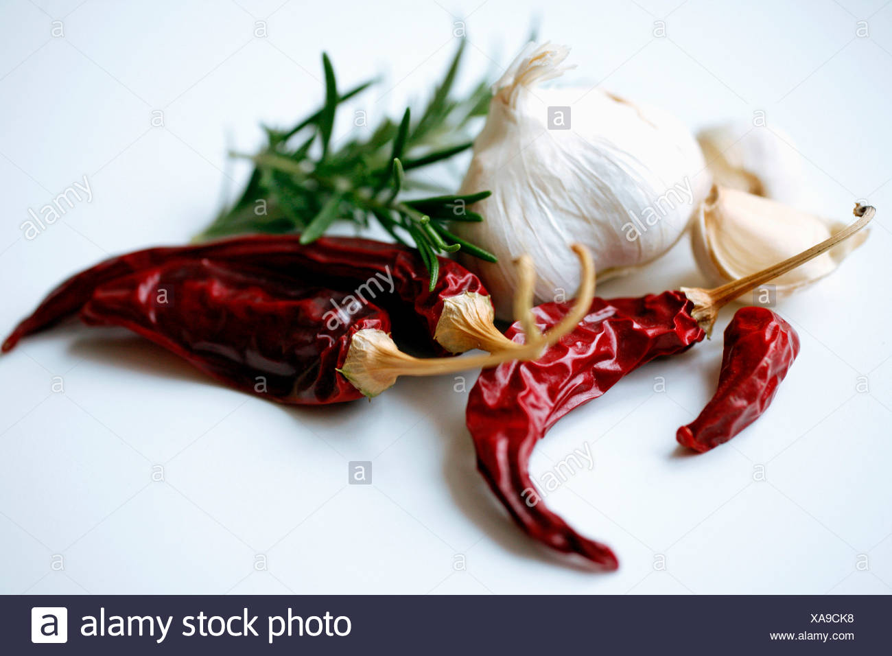 Chili peppers and garlic over white background - Stock Image
