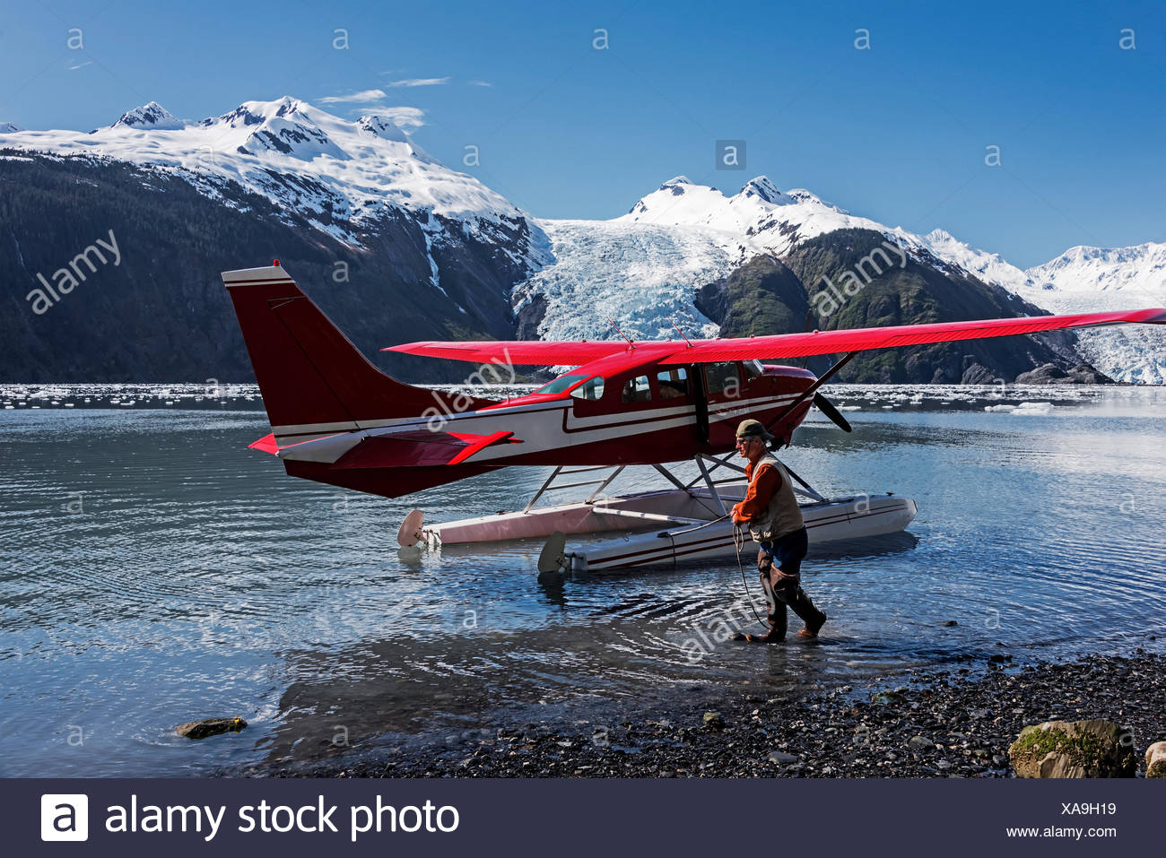 Pilot maneuvers a Cessna 206 floatplane