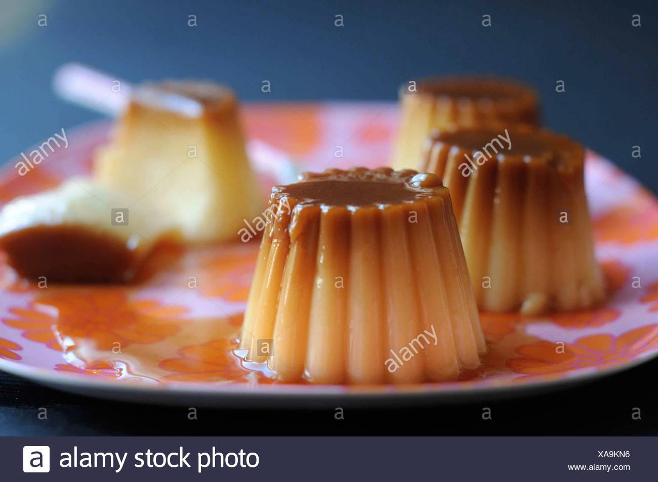Cream Caramel on a flowery tray - Stock Image