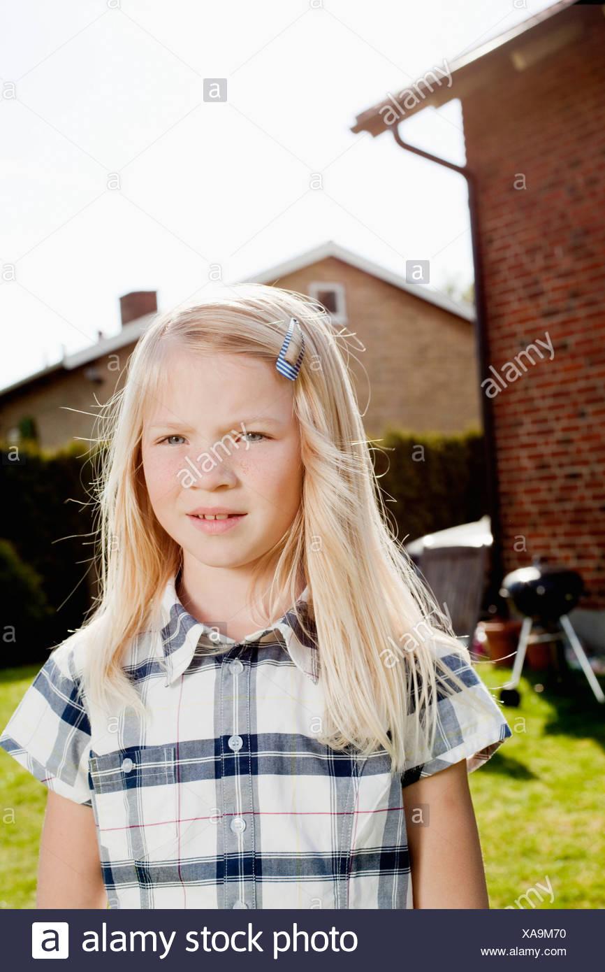 Girl outside house - Stock Image
