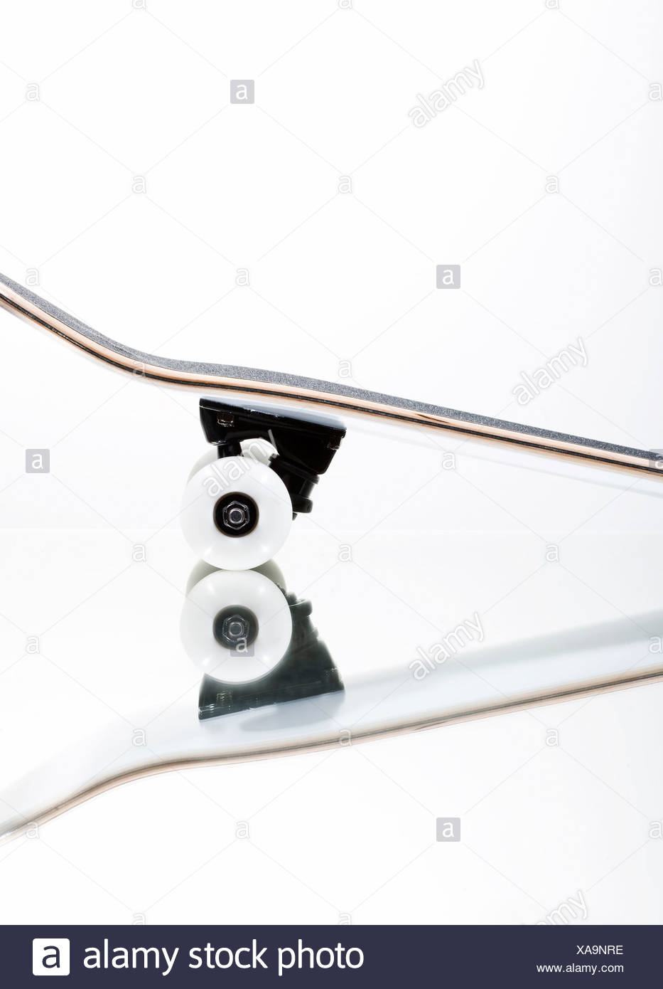 Skateboard on a mirror - Stock Image